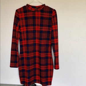 Size Large, plaid, long sleeved, and form fitting